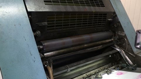 Printing roller helps to deliever sheets of paper into printing press. Printing industry, old mechanism. Seamless loop. 4K Ultra HD.