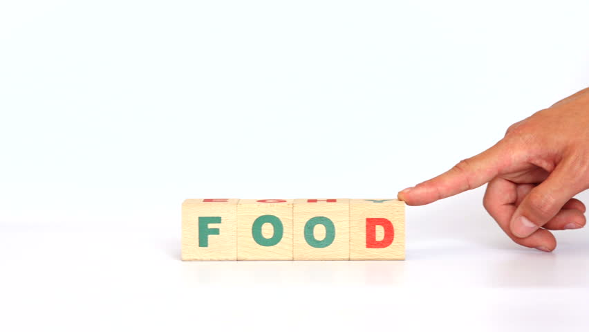 Food word built with wooden cubes on white background. Full word, mixed letters. Related to eating, meal. Stop motion. 4K Ultra HD. | Shutterstock HD Video #18243958
