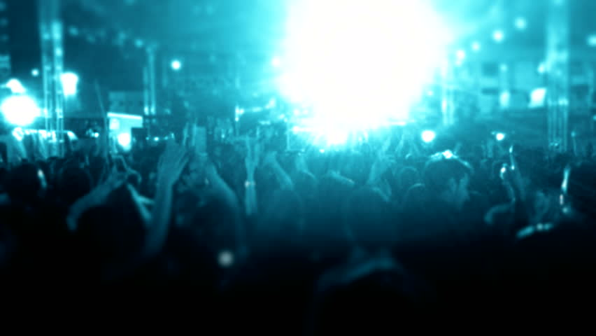 Cheering fans at a life concert | Shutterstock HD Video #18248554