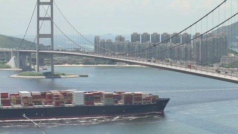 Container Ship Across the Tsing Ma Bridge - Tsing Ma Bridge is a bridge in Hong Kong. It is the world's seventh-longest span suspension bridge.
