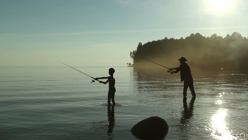 Father and son fishing on the lake.