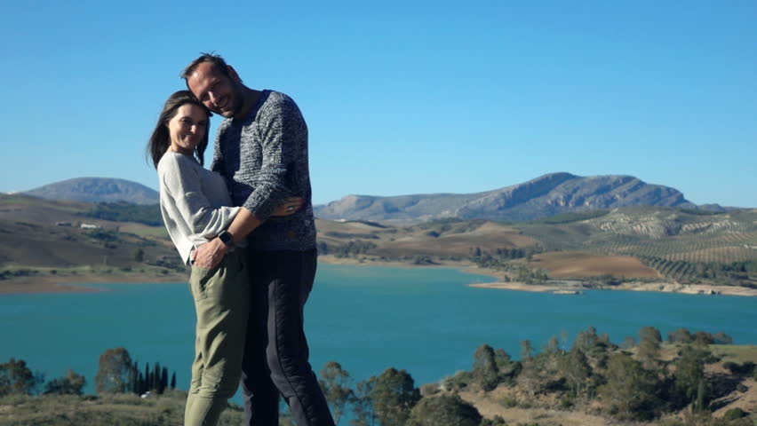 Portrait of happy couple standing near lake in country, super slow motion 240fps  | Shutterstock HD Video #18260953