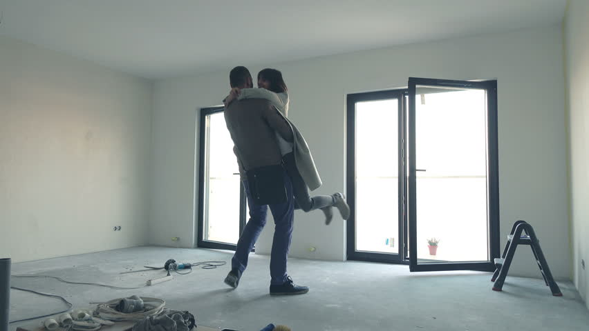 Young, happy couple moving in to their new home   | Shutterstock HD Video #18264478