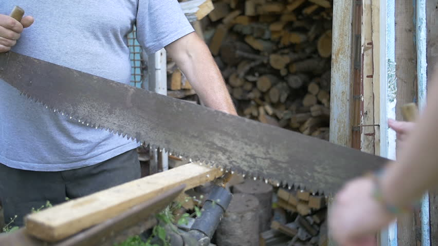 Two men sawing wood, saw Russian friendship, slow motion   Shutterstock HD Video #18274705