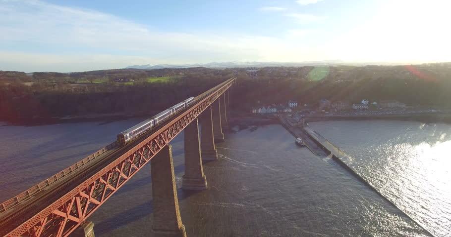 Aerial: Train on Forth Rail Bridge in Queensferry, Edinburgh, Scotland