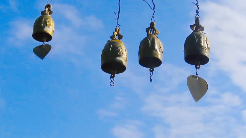 wind chimes on blue sky background