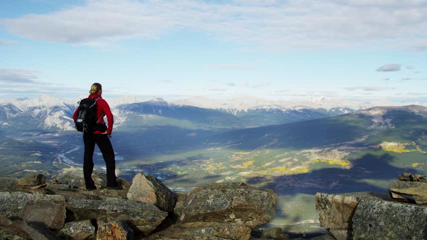 Blonde Caucasian girl in hiking clothing enjoying the National Park view | Shutterstock HD Video #18304204
