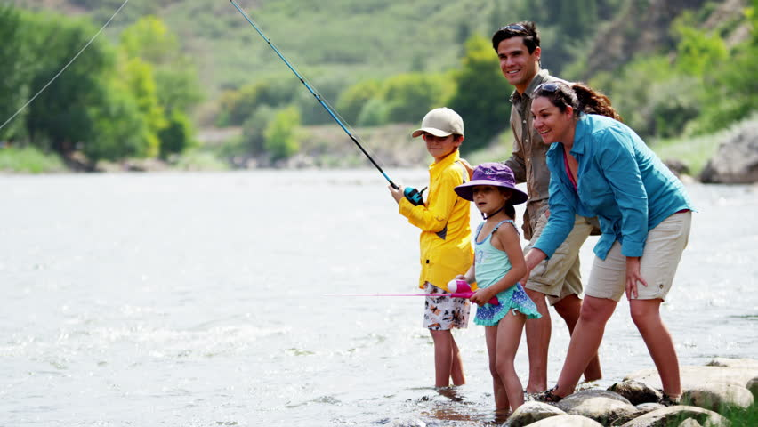 Happy Caucasian family having adventure together fishing on Colorado River