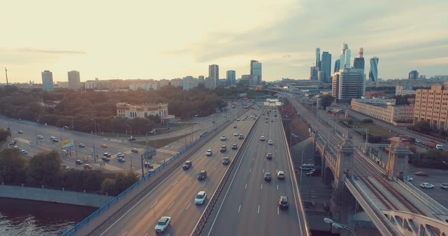 Aerial view of Luzhniki Metro Bridge, also known as Metromost, heavy traffic in the evening, Moscow river and city skyline during sunset. Big city life concept.     | Shutterstock HD Video #18308620