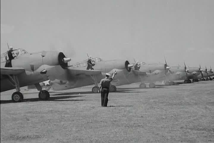 Pilots take ownership of their airplanes and get ready for flight in 1942. (1940s) | Shutterstock HD Video #18313399