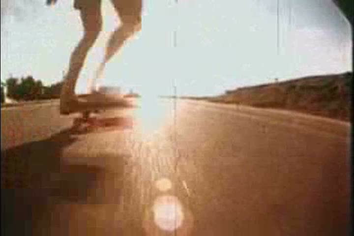 Skateboarders jump over a camera and a single board is showcased in 1976. (1970s) | Shutterstock HD Video #18336172