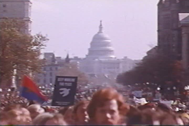 Coretta Scott King and Arlo Guthrie speak to the crowd at the March on Washington in the 1960s. (1960s)