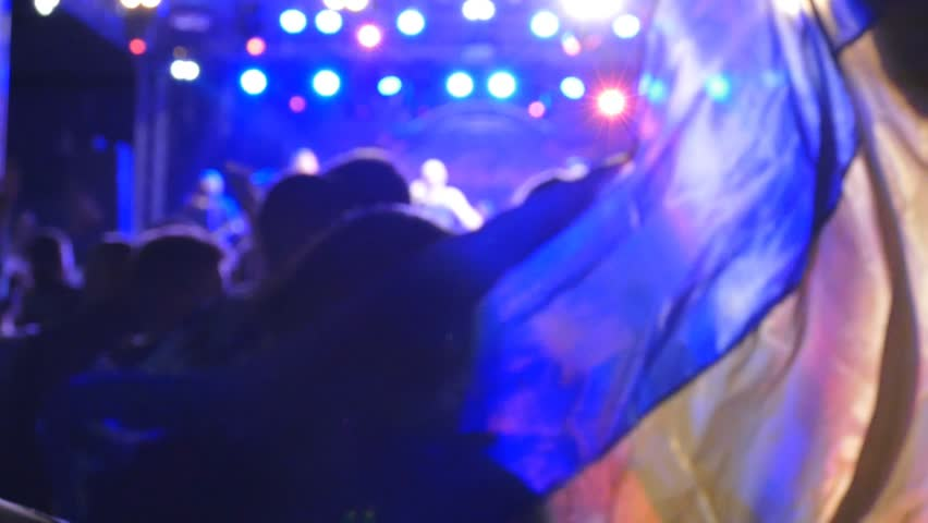 Fans dancing with Ukrainian flag on concert. Slow motion   Shutterstock HD Video #18379987