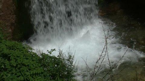 Waterfall ending making white water foam