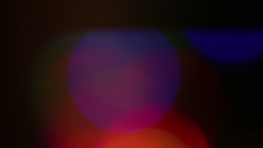 Flashing colored lights. Blurring background. | Shutterstock HD Video #18396427