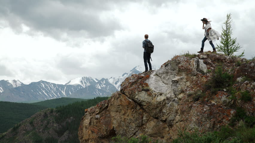 Two people standing on top of a mountain | Shutterstock HD Video #18431431