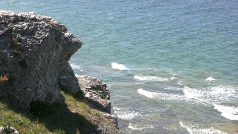 cliff with wavy ocean in the background