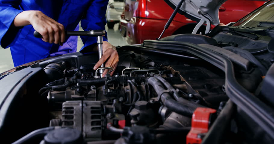 Female mechanic servicing a automobile car at repair shop 4k #18460840