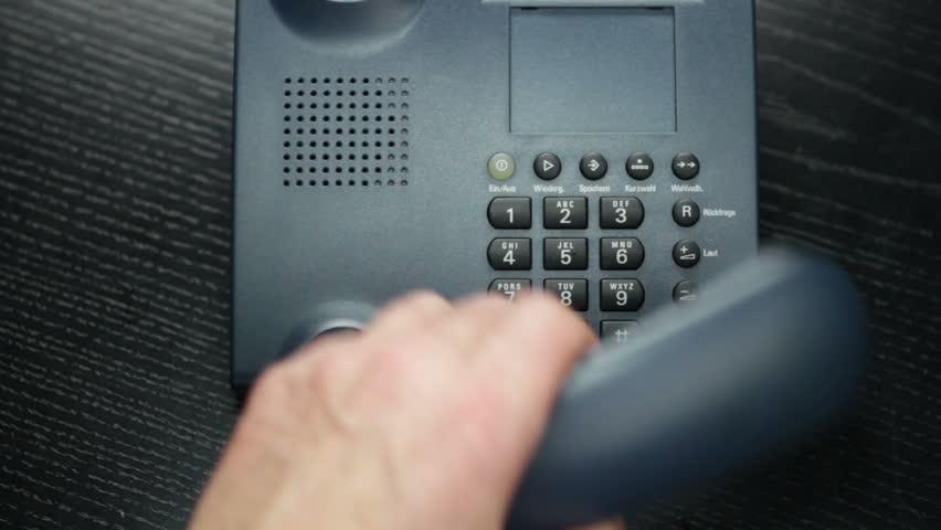 Businessman using Business Phone