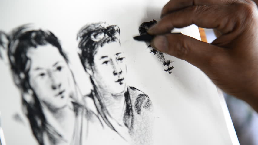 CHIANG MAI, THAILAND - AUGUST 1 : Artist drawing and sketch a portrait with a pencil at Chiang Mai, Thailand.