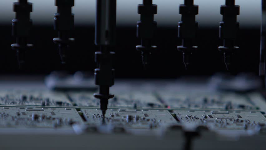 Robotic production of printed Circut Board. Producing Printed Circut Board. Electronics contract manufacturing. Manufacture of electronic chips. High-tech manufacturing. Royalty-Free Stock Footage #18465190