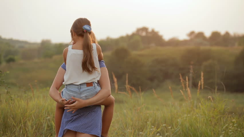 Two sisters in nature. Sisters having fun at sunset.   Shutterstock HD Video #18471460