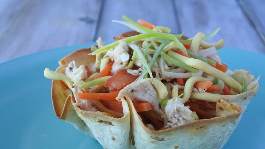 Mexican woman serve a traditional Mexican chicken salad inside a tortilla. Food background copy space #18478273