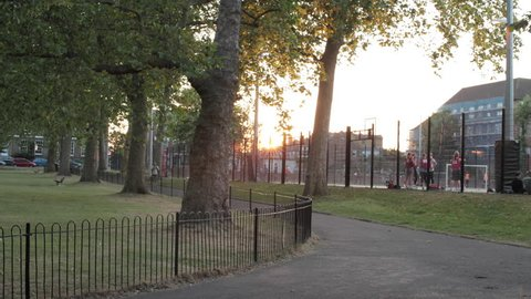 Time lapse of park at sunset in London