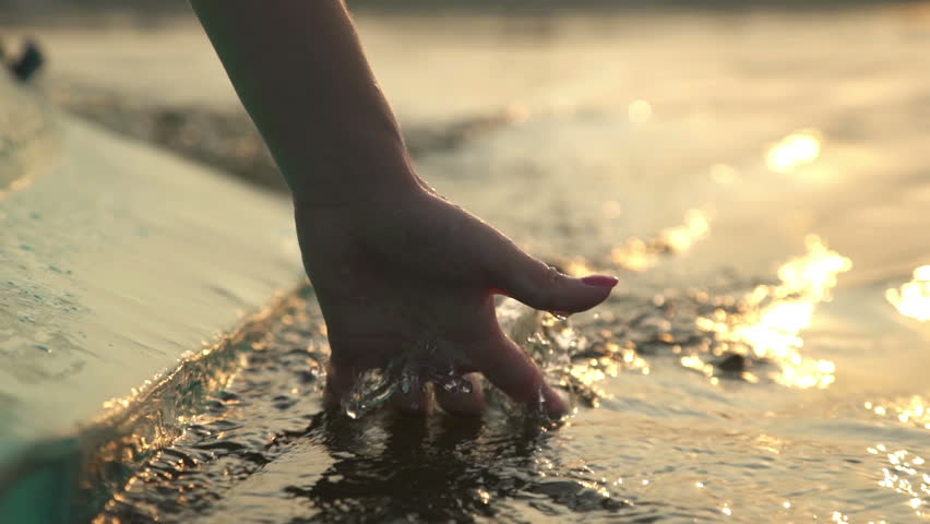 Close-up of girl's hand moving through the water   Shutterstock HD Video #18528074