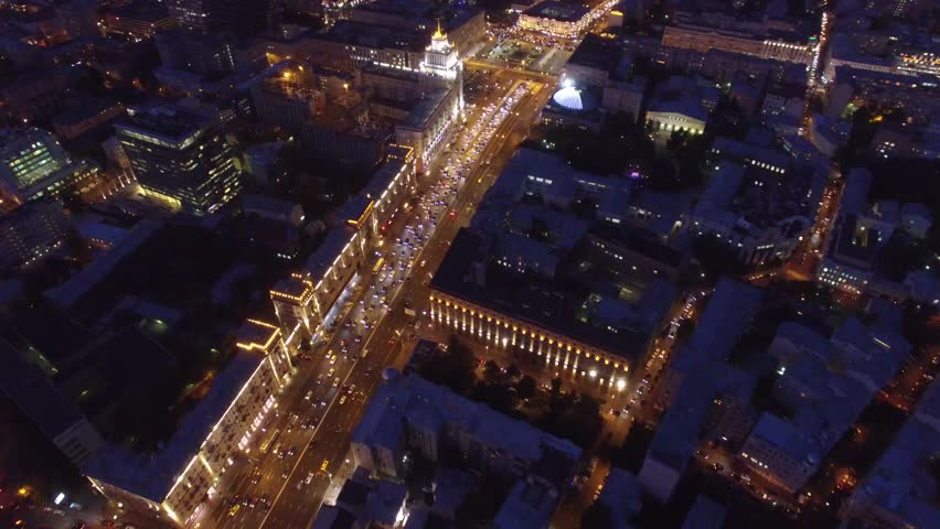 Sadovoe ring evening road traffic. Center of Moscow night illumination. Aerial drone from above view to moving cars. Stalin skyscrapers and modern business centers at background. | Shutterstock HD Video #18545429