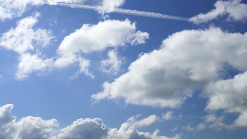 Time lapse of white clouds against a blue sky | Shutterstock HD Video #18551894