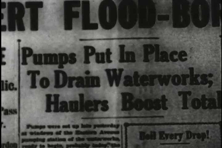 Pumps used to drain water on Eastern Avenue in flooded Louisville, Kentucky in the 1930s. (1930s)   Shutterstock HD Video #18558623
