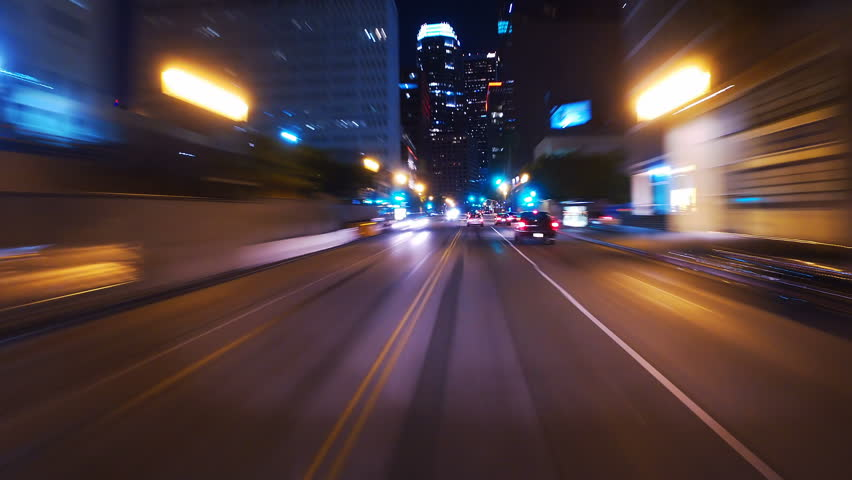 Hyperlapsed view from a car at night. POV. Hollywood, Los Angeles, United States. Perfect to represent concepts as autonomous driving, futuristic cityscape, city life, etc.