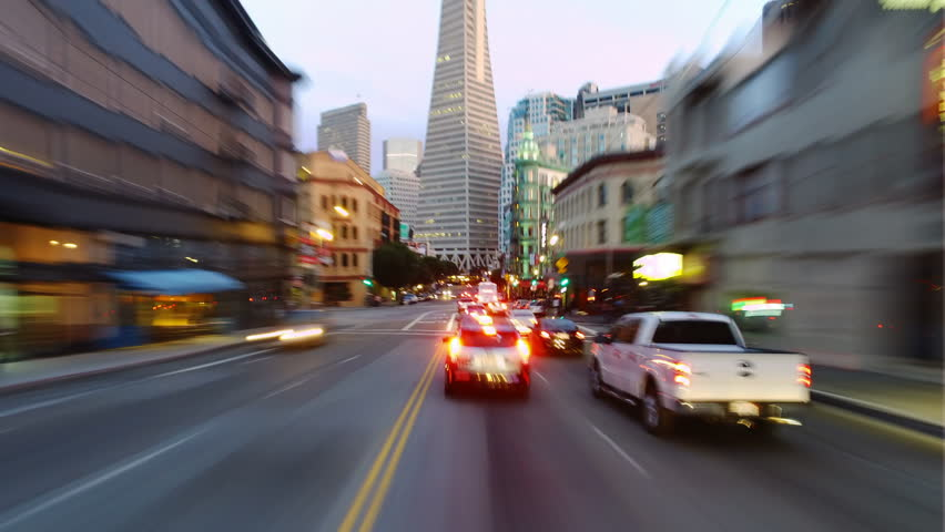Hyperlapsed view from a car. POV. San Francisco financial district and Chinatown. Day to night. Perfect to represent concepts as autonomous driving, futuristic cityscape, city life, etc.