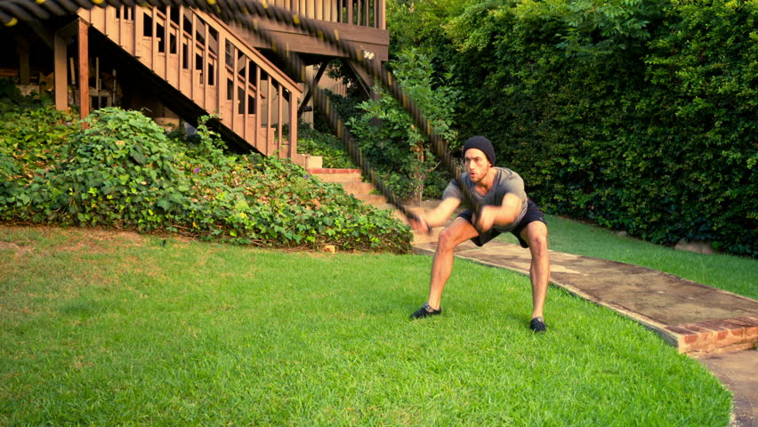 Athletic Male Working Out Using Battle Roles. High-intensity interval training. Slow Motion. #18567353