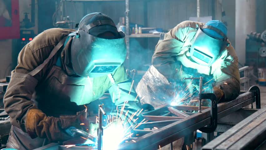 Welder Industrial automotive part in factory | Shutterstock HD Video #18573710
