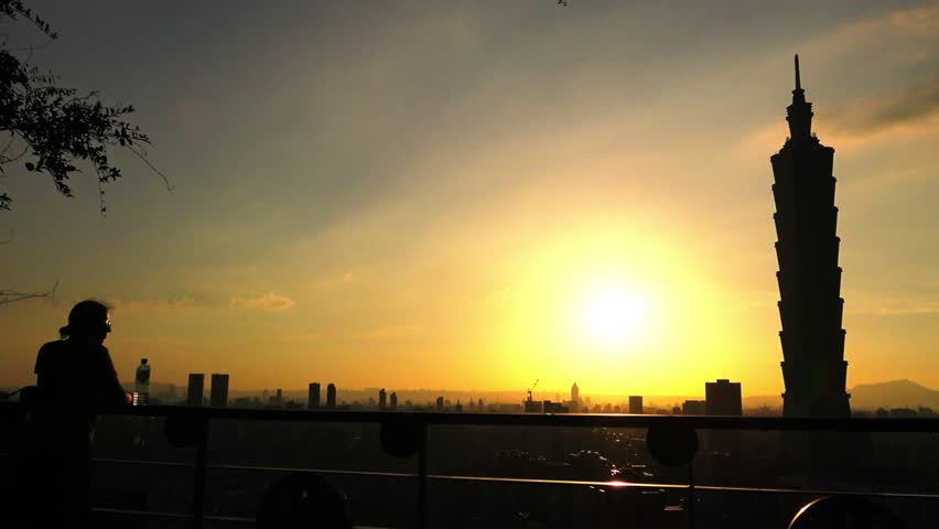 4K Silhouette of Young tourist couple caucasian watching beautiful sunset on the Elephant Mountain with Cityscape Taipei Skyscraper, tall building Taipei 101 in background at Taiwan-Dan | Shutterstock HD Video #18579836