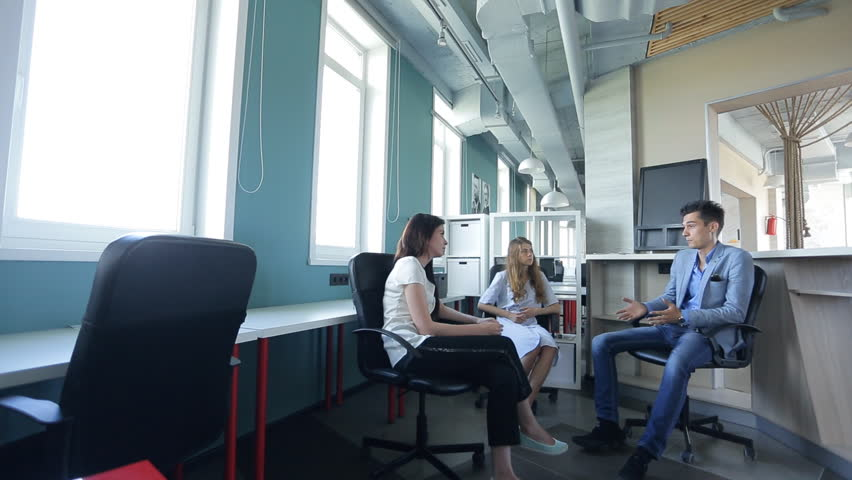 Head of HR specialist recruitment personnel, talking with two young women, in an empty office. | Shutterstock HD Video #18594818