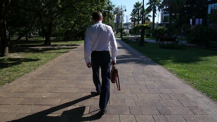 Businessman is walking on a city street | Shutterstock HD Video #18595553