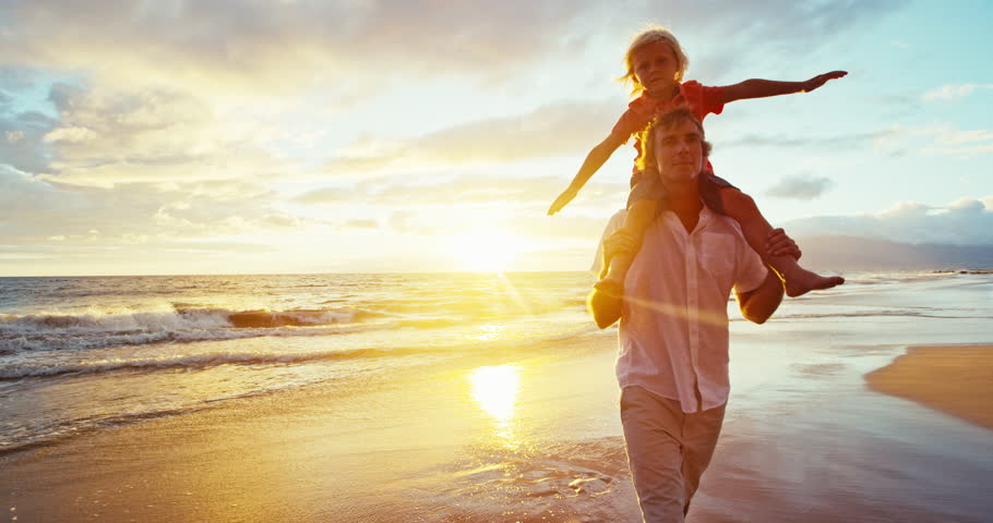 Happy father and son playing on the beach at sunset | Shutterstock HD Video #18597365