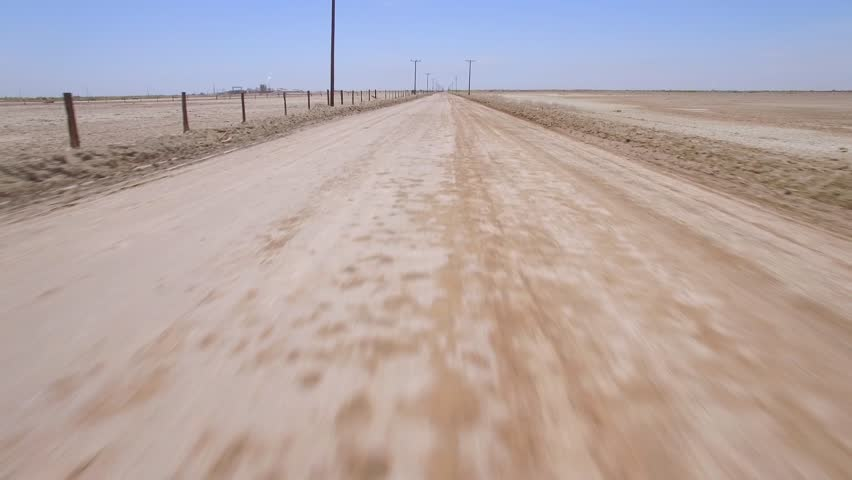 Fly Drive Dirt Road / Multiple clips of driving and flying on a deserted dirt road.
