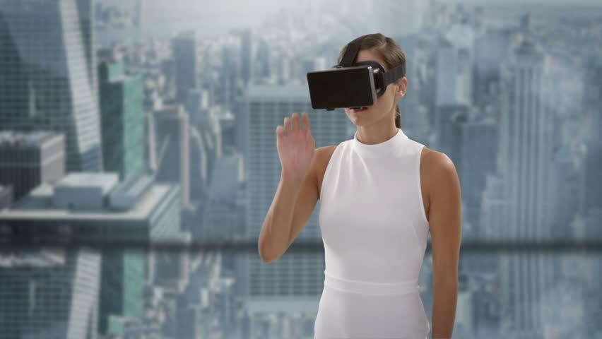Businesswoman wearing virtual reality headset in office