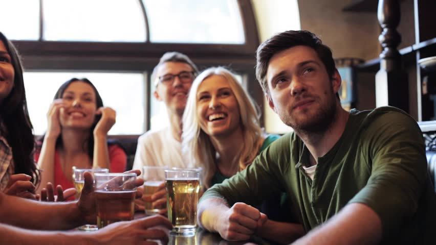 people, leisure, friendship and entertainment concept - happy friends drinking beer and watching sport game or football match at bar or pub #18645125