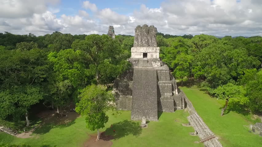 Spectacular aerial shot over the Tikal pyramids in Guatemala. (Guatemala 2010s)