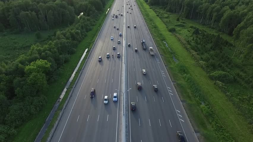 Aerial View of Traffic on a Motorway Ring Road Through a Wooded Area in Moscow City, Russia