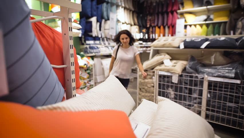 Pretty, young woman choosing a pillow #18667061