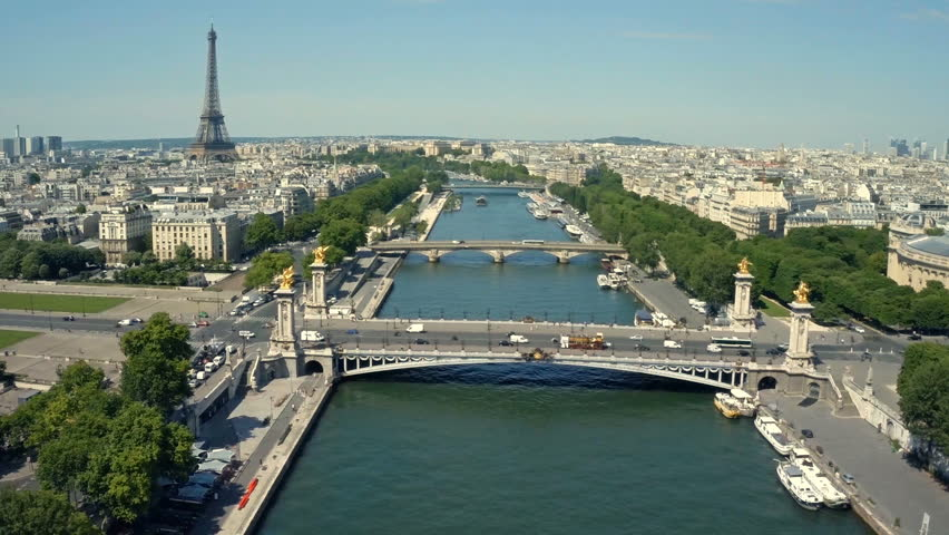 Aerial view of Paris, France with Seine River and Eiffel tower in background.