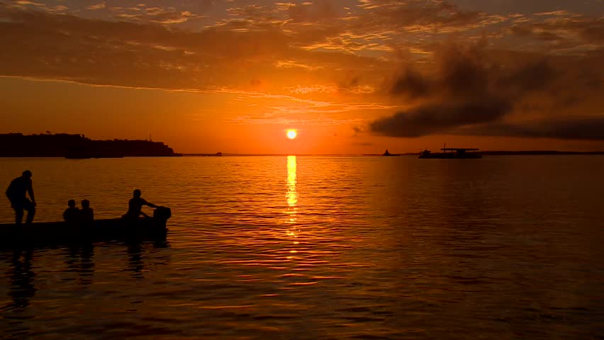 Sunset with boat on the river, Manaus, Brazil 2015