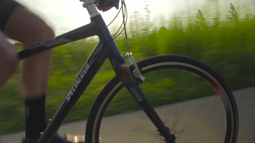 Traveling shot of a mountain biker riding on a park trail near Chicago. (Chicago 2010s)   Shutterstock HD Video #18682961