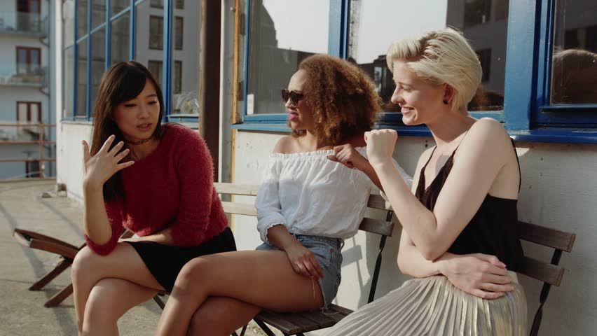 Group of female friends meeting in a coffees hop. Three young women at outdoor cafe gossiping and enjoying.  | Shutterstock HD Video #18684983